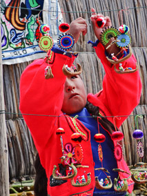 Girl displaying her crafts on the floating island of Uros