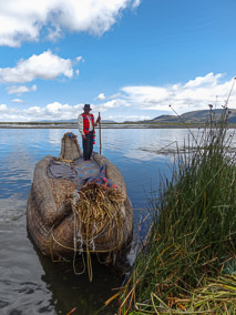Man on his totora reed boat on the floating islands of Uros