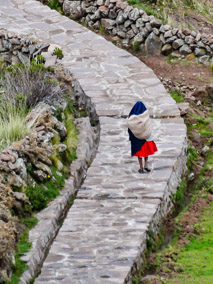 Woman walking down a pathway on Taquile Island