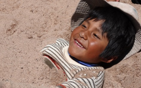 Wilfredo happily buried in the sand