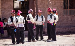 Group of married Taquile men in the main square