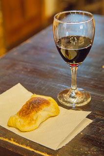 Wine glass and empanada in a Mendoza winery