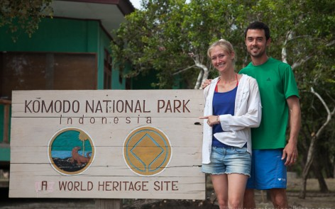 Kenny and Laura in front of the Komodo National Park sign on Rinca island