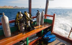 A view from the rear of the boat with dive tanks and other dive equipment