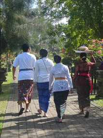 Group of Balinese walking to Royal Family Temple