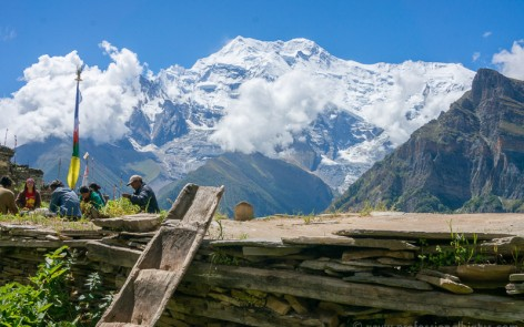 Locals working amid mountain views on Annapurna Circuit
